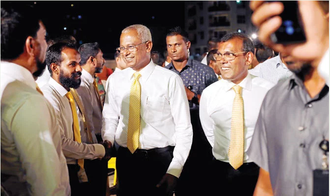 Maldives President Ibrahim Mohammed Solih with former President Mohammed Nasheed. (Reuters)
